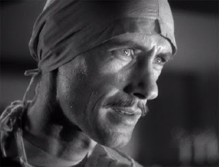 John Carradine as mad scientist Sigmund Walters