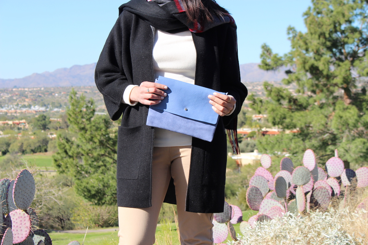This is a close-up of the accessories and outfit details I'm wearing, with the desert in the background.