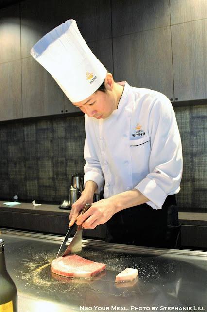 Cooking the beef at Mouriya Honten in Kobe, Japan