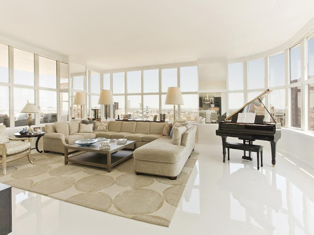 Photo of modern bright living room with piano in New York penthouse
