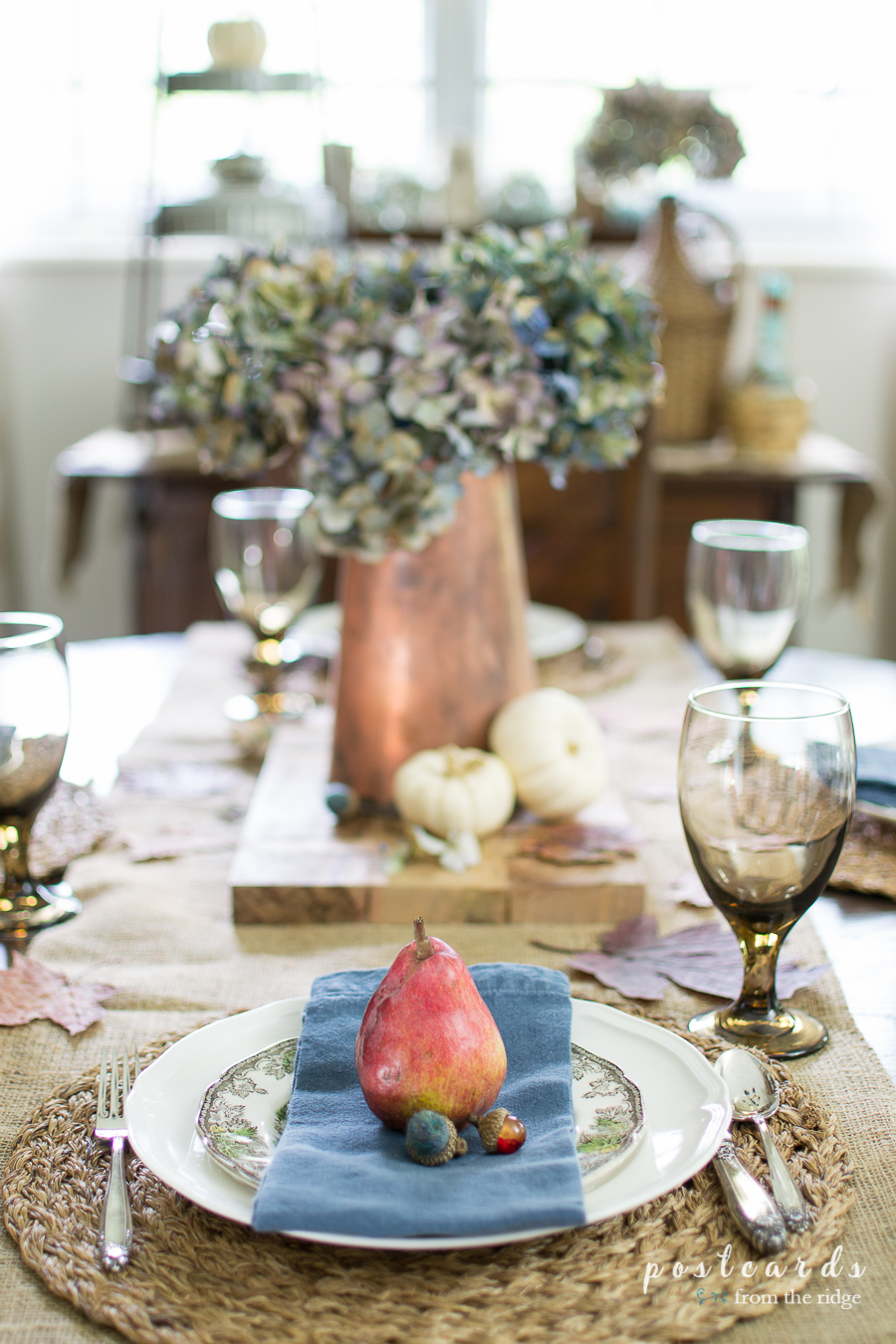 red pear and blue napkin table setting