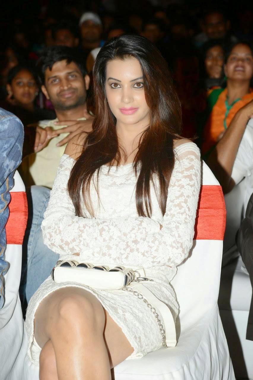 Diksha Panth Wallpapers, Actress Diksha Panth Crossleg Sitting Pics in White Dress from Event