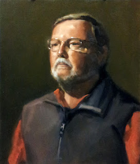 Oil painting of a man with a grey beard and glasses wearing a blue and red top.