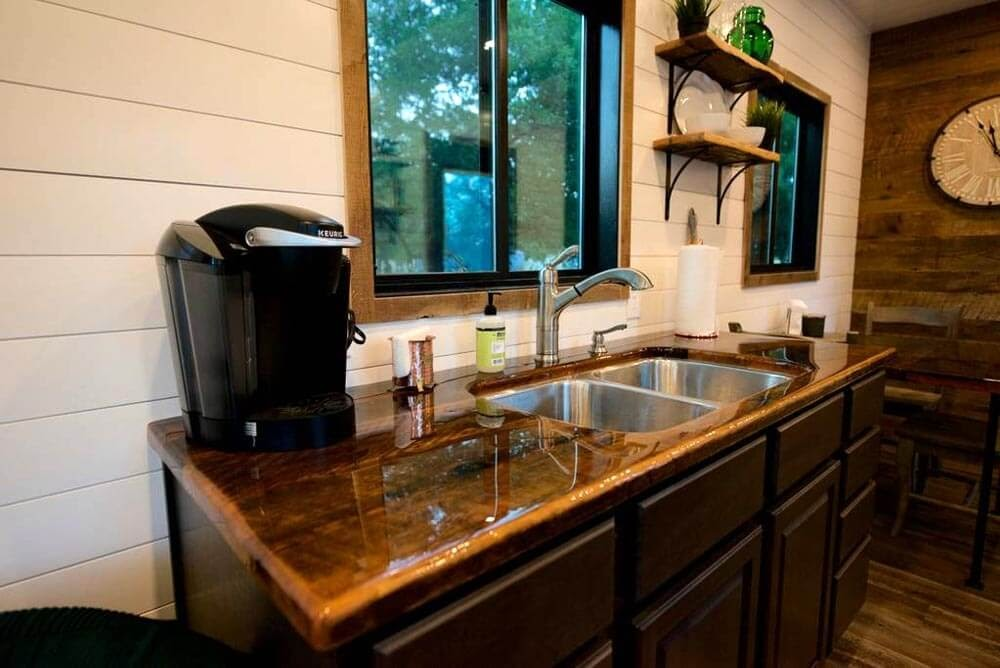 04-Kitchen-Area-Cargohome-Sustainable-Two-Story-Tiny-Home-Shipping-Containers-www-designstack-co