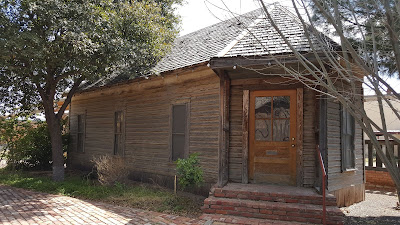 Photo of the Mesquite House, the oldest house in Pecos Texas.