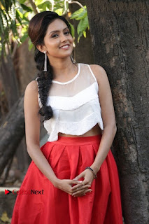 Actress Mahima Nambiar Latest Stills in White Top and Red Skirt at Kuttram 23 Movie Press Meet  0016.jpg