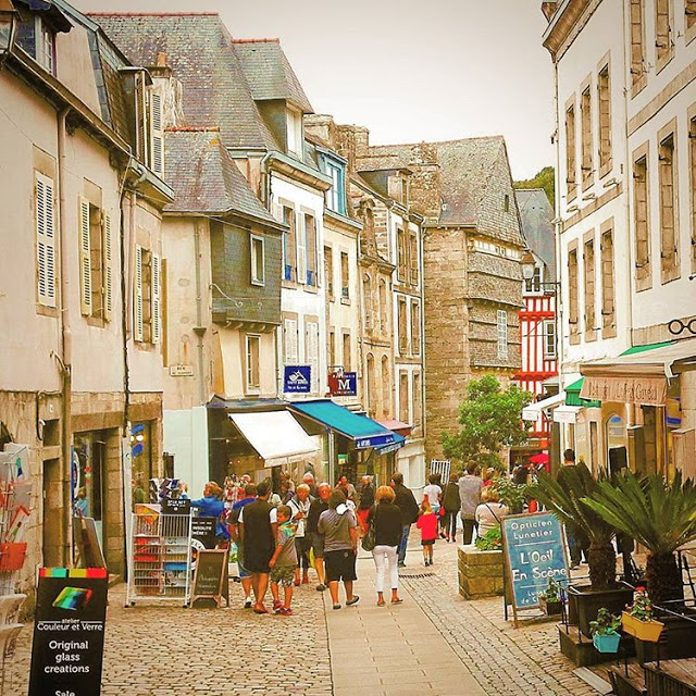 Tourists are walking in the city center of Quimper