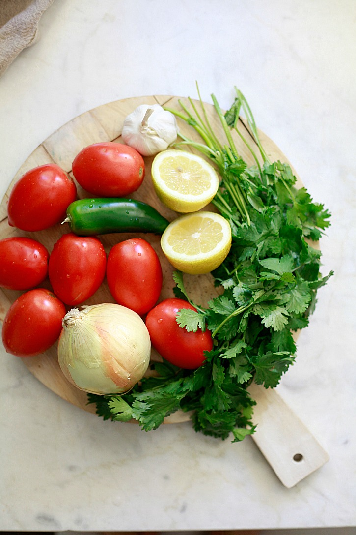 The ingredients for fresh salsa include tomatoes, jalapeno, onion, lemon juice, garlic, and cilantro.