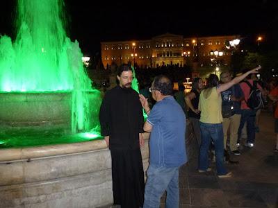 15 Σεπτεμβρίου 2015 Συζητώντας με το μοναχό Εφραίμ στο Σύνταγμα το βράδυ πριν τα δακρυγόνα... Την άλλη μέρα ήταν εκεί. Τον έχασα μέσα στο πλήθος