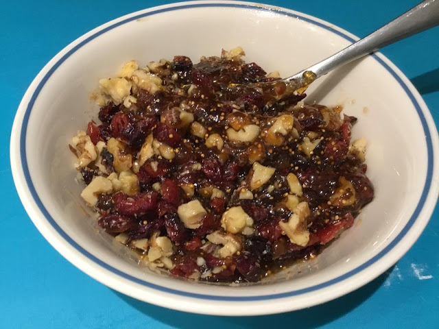chopped figs, walnuts and cranberry topping for brie