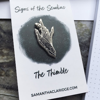 the thimble hand constellation enamel pin