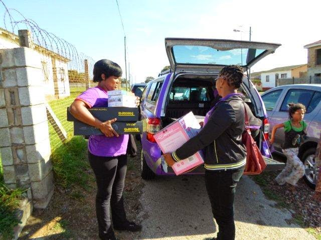 The Hollywoodbets Parliament Street team unloading goods for the Zanethemba Charity Foundation (PE)