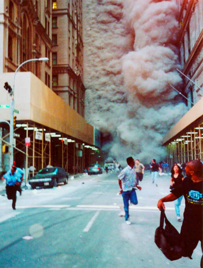 18 Rare Historical 9/11 Photos That You Most Possibly Haven't Seen Before - People Run Down Broadway As A Smoke And Dust Cloud Comes Up The Street From The Collapsing World Trade Center Buildings In New York