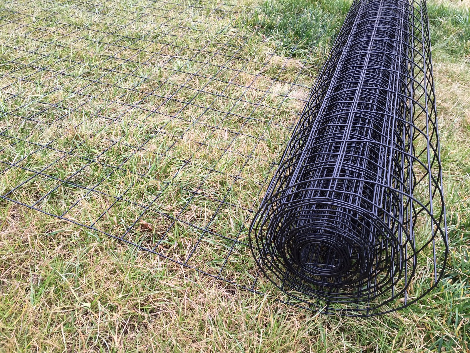 roll of black vinyl coated welded wire fencing