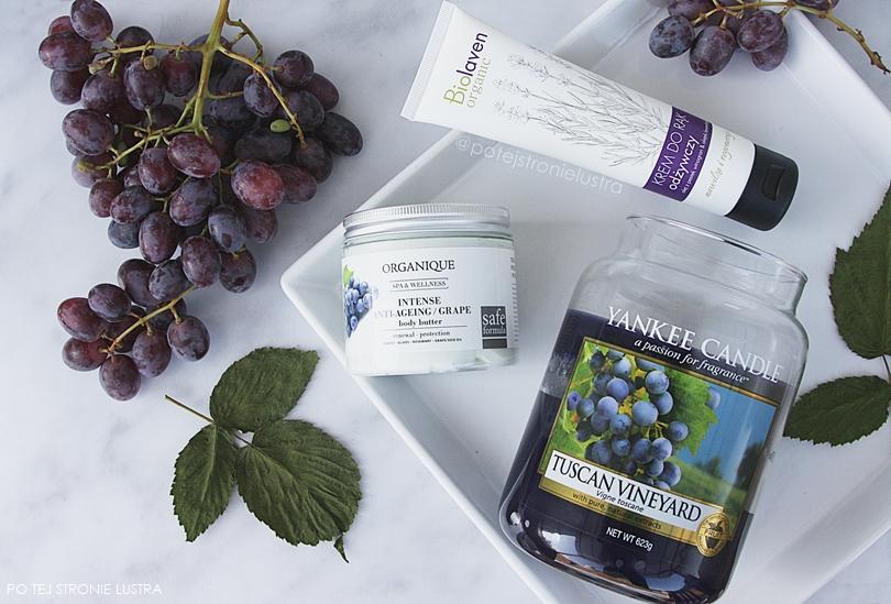 kosmetyki i świeca o zapachu winogron