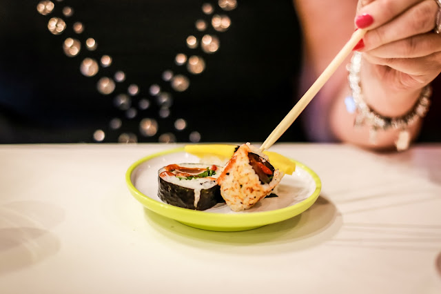 healthy sushi food, lady eating with chopsticks