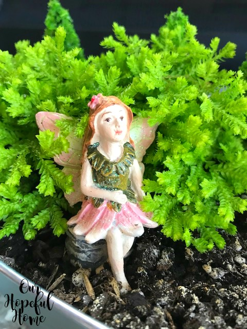 fairy sitting garden green leaves