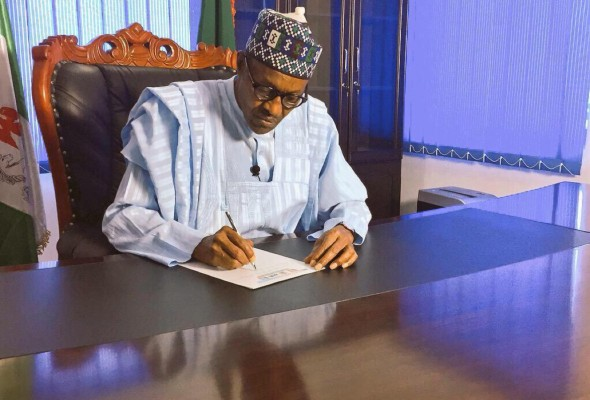 LATEST NEWS: president Buhari signs three bills into law