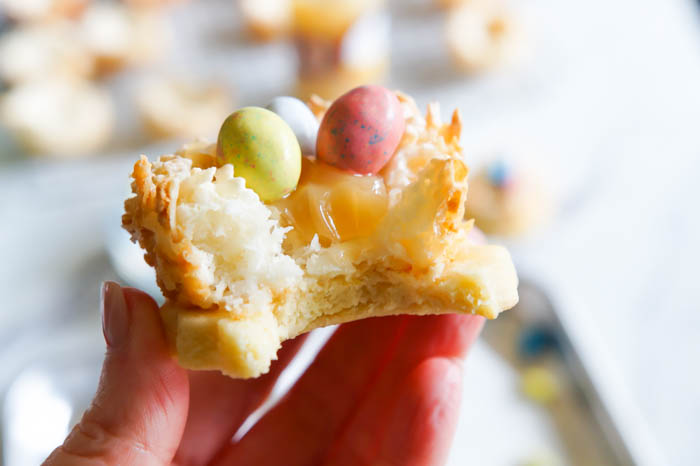 Lemon Coconut Bird's Nest Cookies...a coconut macaroon nest atop a buttery lemon cookie with lemon curd and chocolate eggs.