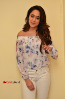 Actress Pragya Jaiswal Latest Pos in White Denim Jeans at Nakshatram Movie Teaser Launch  0033.JPG