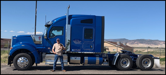 Larry Martin stands with his 2019 Kenworth W990