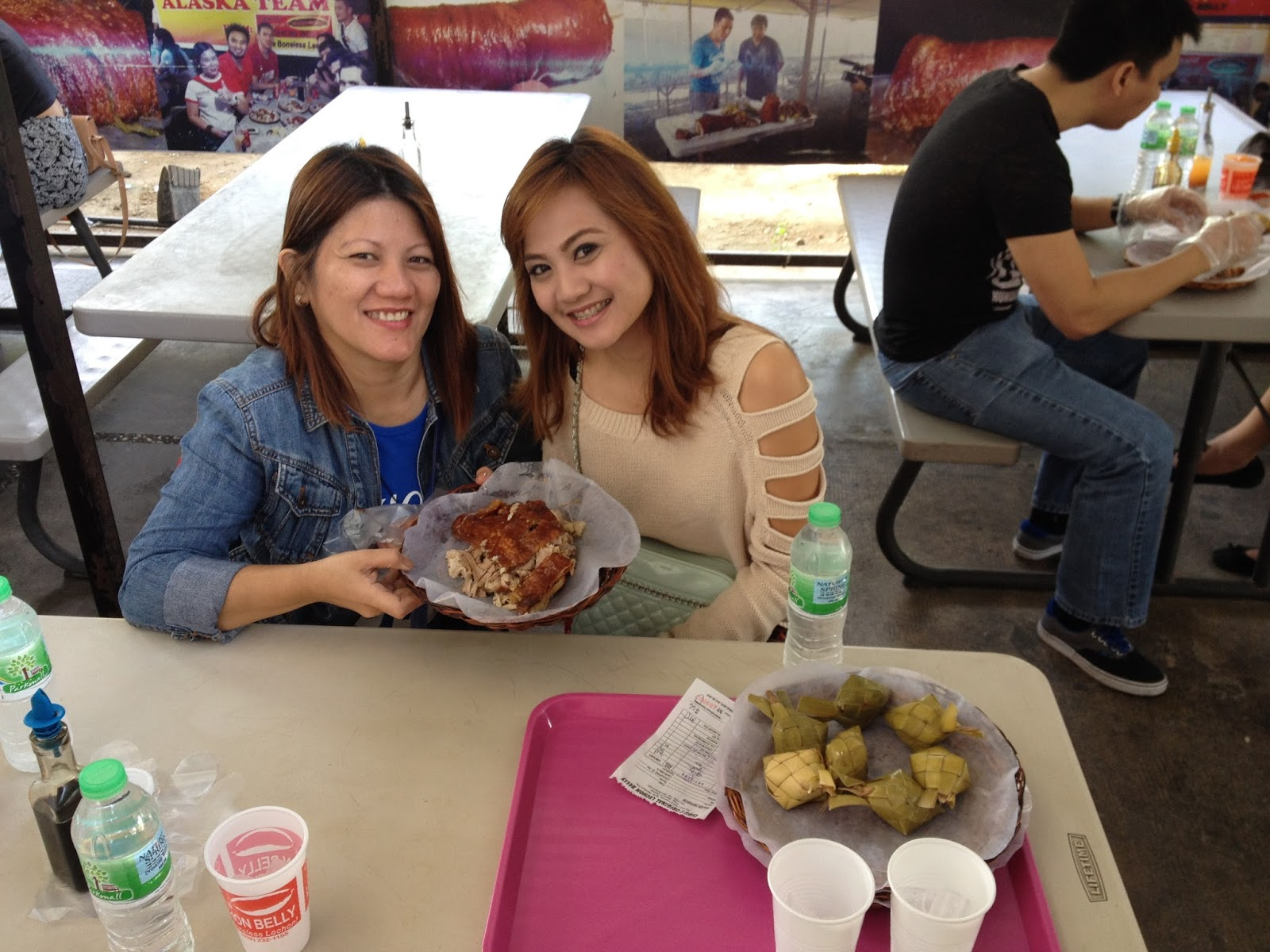 enjoying lechon belly in Parkmall Cebu