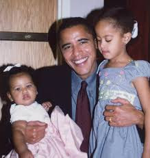 Obama with her daughters