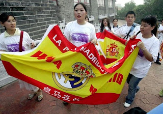Real Madrid's China fans with a flag of the Spanish team