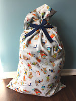http://www.marymarthamama.com/crafty-cat/santa-bag-tutorial/