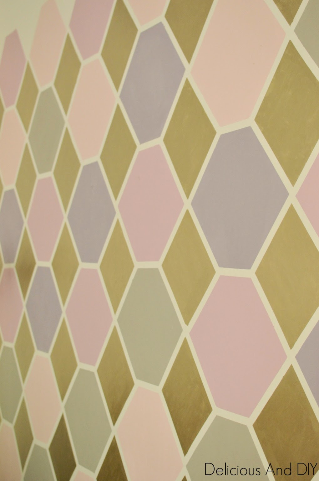 Anam from Delicious and DIY has an eye for pattern, here's a beautiful hexagonal wall she painted.