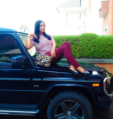 Chika Ike poses with her G-Wagon rocking her Chanel Bag