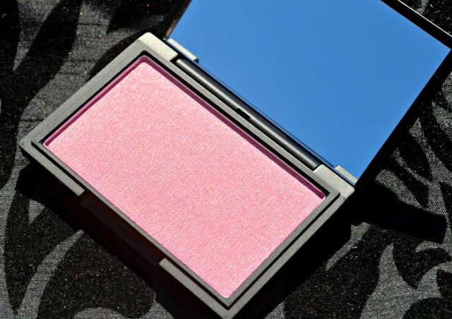Image of the open blusher compact with the mirror and blush pan visible