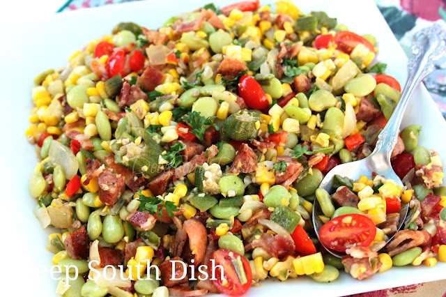 Basic lima bean and corn succotash gets a boost from summer bounty with the addition of sweet Vidalia onions, fresh tomatoes, bell pepper, okra and some smoked meat.