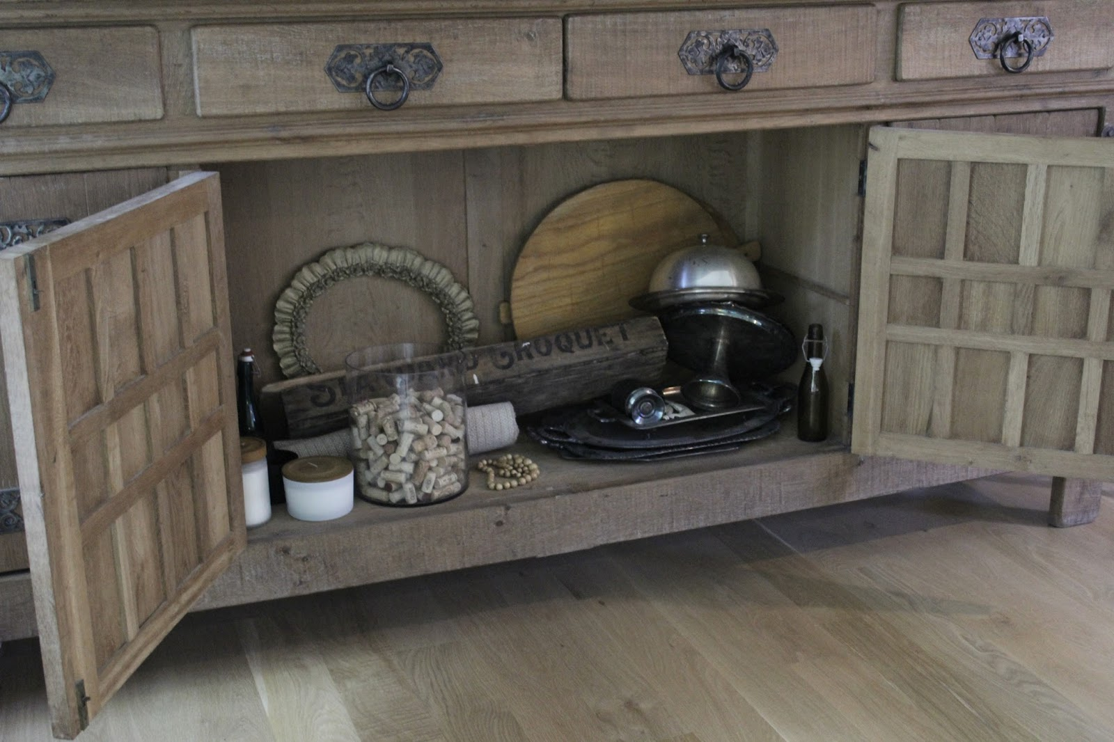 Rustic oak Belgian antique cupboard in European country styled living room by Hello Lovely Studio