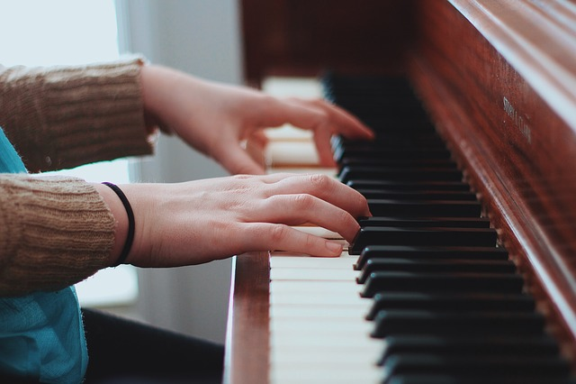 Close-up of woman playing the piano