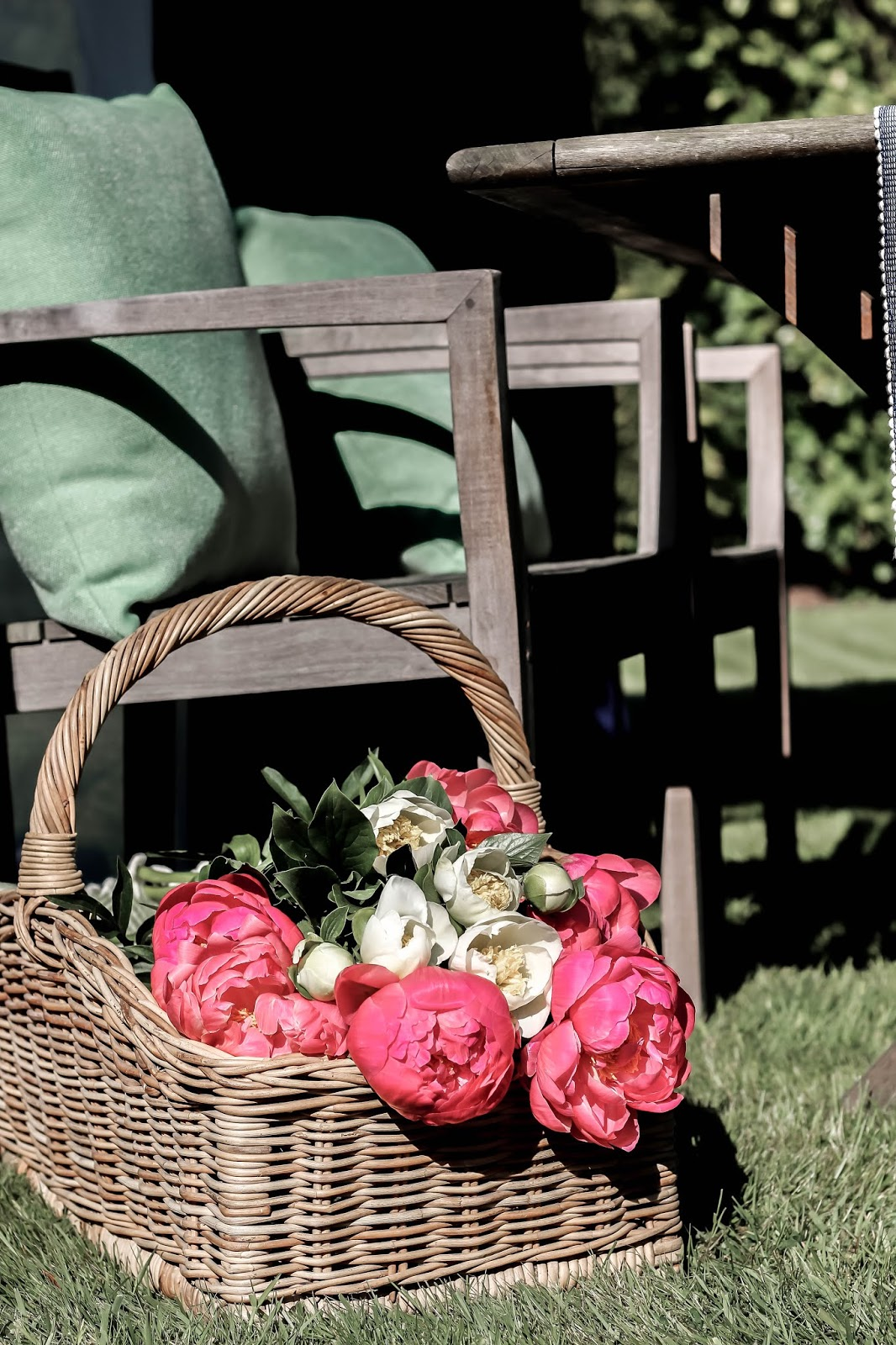 Straw Basket Filled with Flower Bouquets Peonies