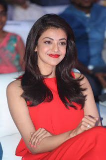 Kajal Aggarwal looks so cute in a red jump suit at Oopiri audio launch