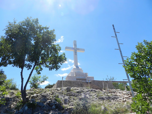 The view of the cross at Cross Mountain after the last Stations of the Cross prayer plaque.