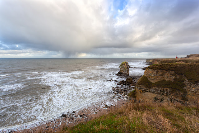 North East coastline at Marsden with stormy clouds and rock stacks