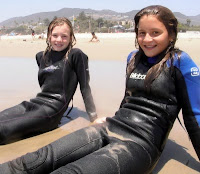 2 Aloha Beach Camp girls looking for some good waves at Zuma Beach in Malibu.