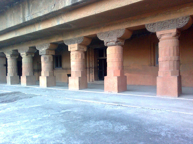 The massive octagonal columns in front of the porch - Ajanta cave 4