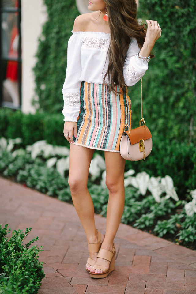 off-shoulder blouse paired with colorful skirt