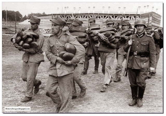 Polish POW carry loaves of bread escorted  German soldier