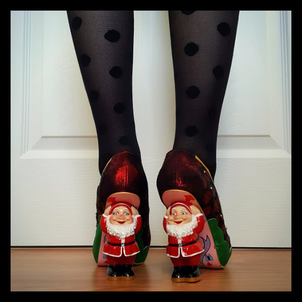 close up of Santa character heels on shoes being worn