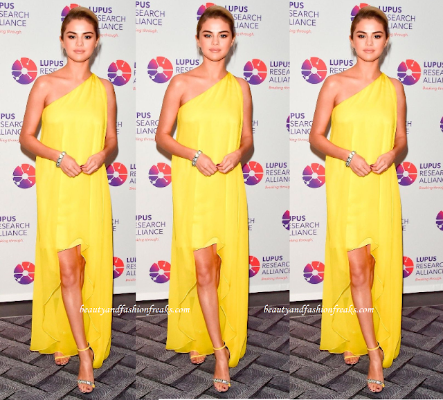 Selena Gomez in a Yellow dress by Calvin Klein