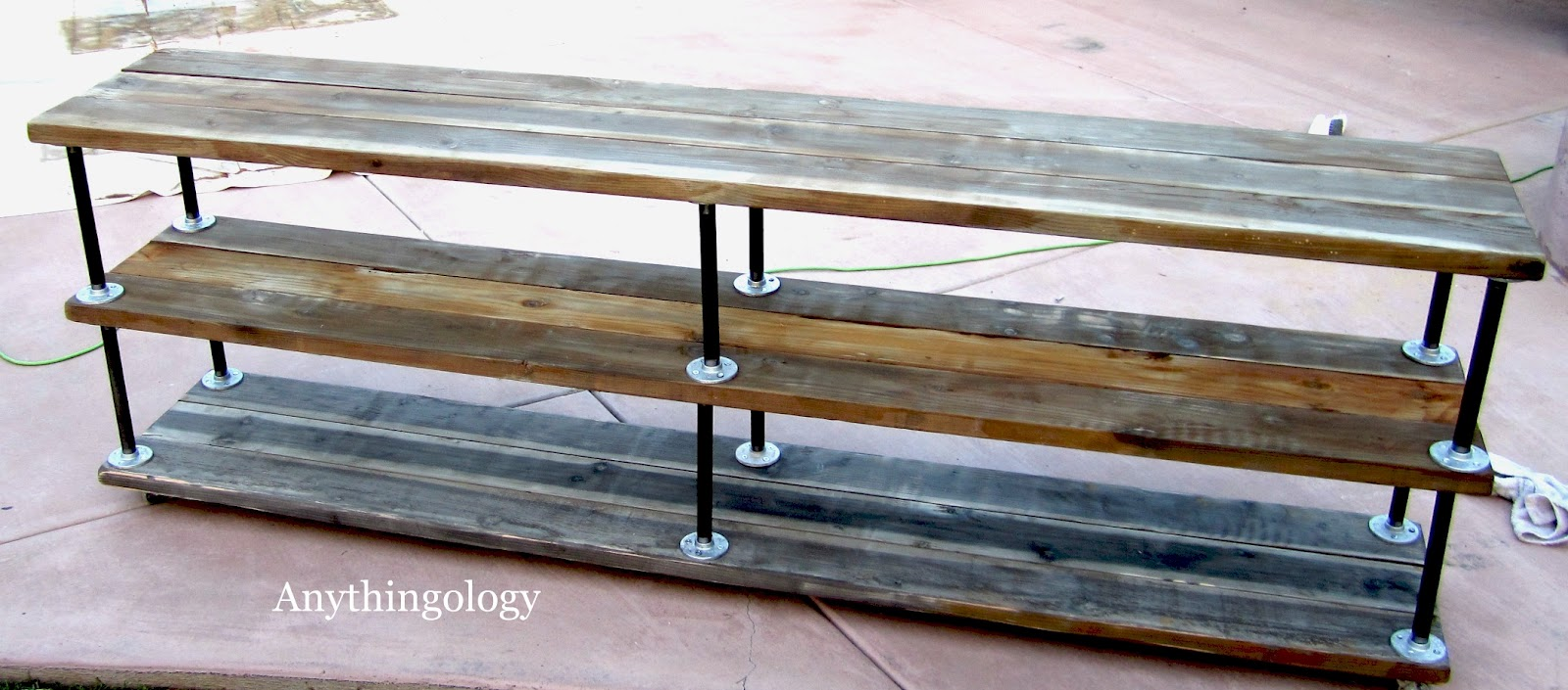Anythingology diy industrial shelves for Diy galvanized pipe table