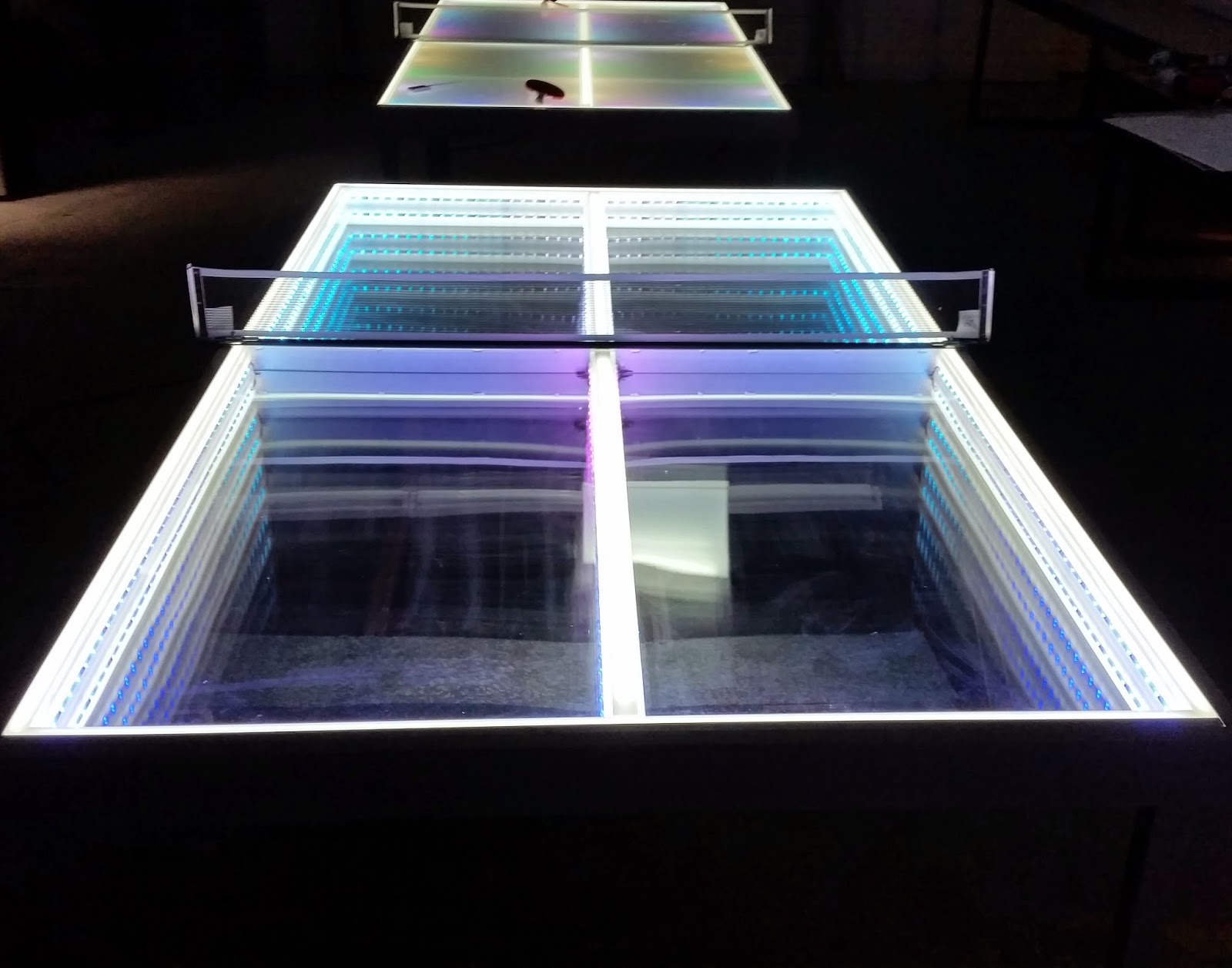 The Lighted Ping Pong Tables Split Into Two Halves For Easy Storage Lighting Programs Included Offer Hundreds Of Moving Color Changing