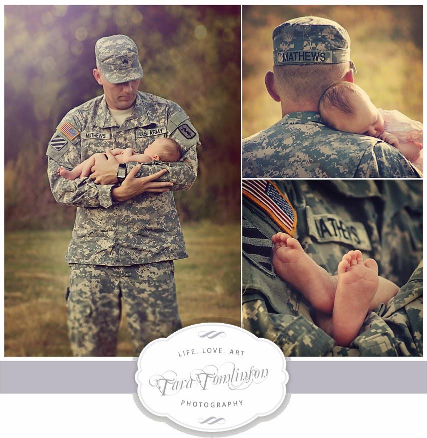 Padre militar cargando a su hijo