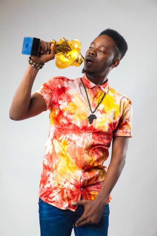 Adekunle gold with headies award