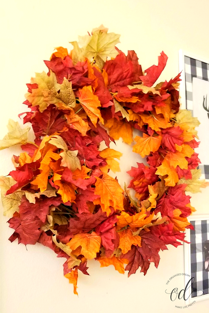 Easy to make fall wreath using dollar store leave bunches.